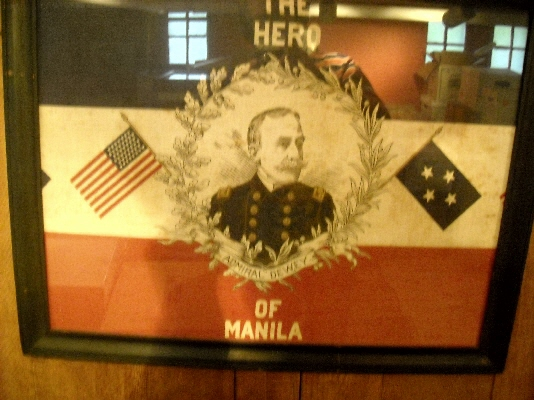 "Image for ""The Hero of Manila: Admiral Dewey"". Patriotic cloth bunting for Admiral Dewey's banquet in Washington following his victory at Manila Bay in 1898."